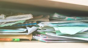 Stacks of notebooks and school supplies - mess Stock Image