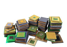 Stacks of old CPU chips and obsolete computer processors isolated on white background Royalty Free Stock Photos
