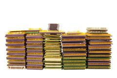 Stacks of old CPU chips and obsolete computer processors isolated on white Royalty Free Stock Images