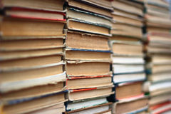 Stacks of old hardback and paperback books. Background image Royalty Free Stock Images