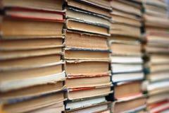 Stacks of old hardback and paperback books. Background image Royalty Free Stock Images