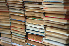 Stacks of old hardback and paperback books. Many stacks of old hardback and paperback books Royalty Free Stock Image
