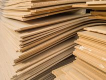 Stacks of old MDF of poor quality. Selective focus stock images