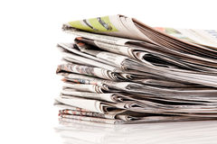 Stacks of old newspapers. Old newspapers and magazines in a pile Royalty Free Stock Image
