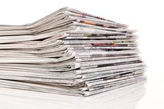 Stacks of old newspapers and magazines. Old newspapers and magazines in a pile Royalty Free Stock Image
