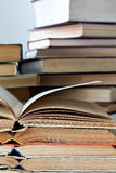 Stacks of old opened books royalty free stock image