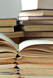 Stacks of old opened books and pencil. Closeup view royalty free stock image