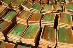 Stacks of old orange weathered roof shingles. Stock Photography