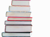 Stacks of Old Textbooks. Old Textbooks stacked on a blank background Stock Photos