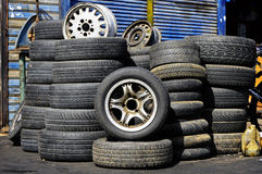 Stacks of old tires in front of the auto service station Royalty Free Stock Image