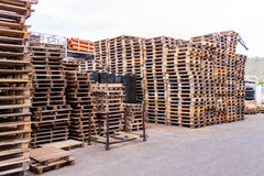 Stacks of old wooden pallets in a yard Stock Photos
