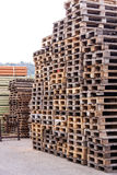 Stacks of old wooden pallets in a yard Stock Photo