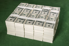 Stacks of one million US dollars in hundred dollar banknotes on. Green table royalty free stock photography