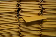 Stacks of Padded Shipping Envelopes stock images