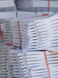 Stacks of paper at a printshop Royalty Free Stock Images