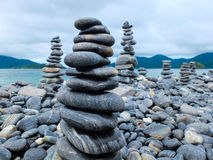 Stacks of pebbles on a beach Royalty Free Stock Images