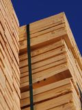 Stacks of planks against the deep blue sky Royalty Free Stock Images