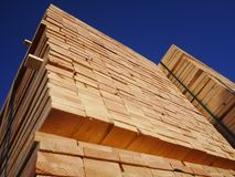 Stacks of planks against the deep blue sky Royalty Free Stock Photo