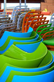 Stacks of plastic chairs Royalty Free Stock Images