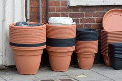 Stacks of plastic flower pots for sale outside shop Royalty Free Stock Images
