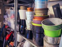 Stacks of plastic pots and vases for flowers and plants standing royalty free stock image