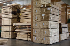 Stacks of plywood piled up in warehouse Stock Images