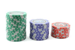 Stacks of poker chips. Stacked green, blue, and red poker chips displayed on a white background Royalty Free Stock Image
