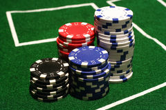 Stacks of Poker Chips. On a green felt table Royalty Free Stock Image