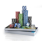 Stacks of poker chips on a book. Stock Photos