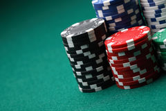 Stacks of poker chips on a green surface. Royalty Free Stock Photos