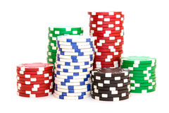 Stacks of poker chips including red, black, white and green Stock Photos