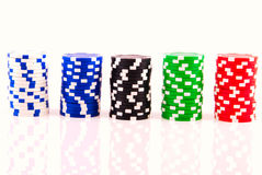 Stacks of poker chips isolated on white Royalty Free Stock Photo