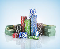 Stacks of poker chips with stack of dollars. Stock Photos