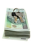 Stacks of Polish money and house keys Royalty Free Stock Photos