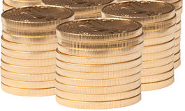 Stacks of pure gold coins. Vertical stacks of gold coins isolated from background stock photo