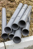 Stacks of pvc pipes at construction site Stock Image