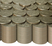 Stacks of quarters with golden tones Stock Image