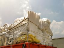 Stacks of recycled papers and foam and plastic garbage bags on the truck,Pile of trash on the truck. Waste recycling environment industry industrial ecology stock photo