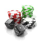 Stacks of red, green, black gambling chips and black dices Stock Photo