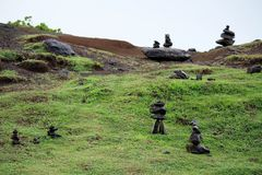 Stacks of Rocks on a Green Hillside Royalty Free Stock Image