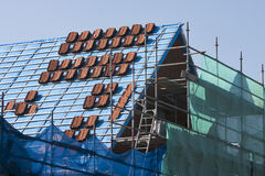 Stacks of roof tiles on a roof under construction Stock Images