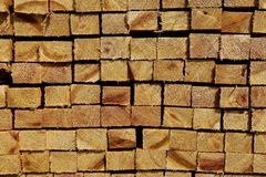 Stacks of rough cut dimensional lumber. Stacks of rough sawed dimension lumber from a sawmill are exposing the end grains stock photo