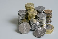 Stacks of Ruble coins on solid color background.  Royalty Free Stock Photo