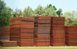 Stacks of rusty steel mats, trees Stock Images