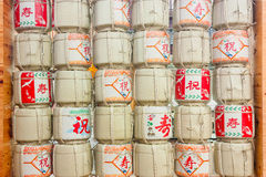Stacks Of Sake Japanese Barrels Background With Kanji Letter Mea Stock Image