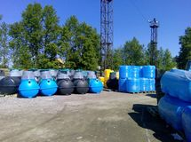 Stacks of septic tanks and other storage tanks at the shipment depot Royalty Free Stock Photography