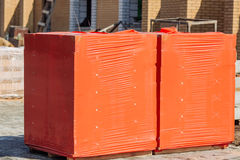 Stacks of silicate bricks on wooden pallets and in polyethylene Royalty Free Stock Photos