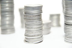 Stacks of silver coins Stock Images