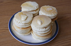 Stacks of Silver Dollar Pancakes. A plate with stacks of small silver dollar pancakes with melting butter Royalty Free Stock Photography