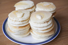Stacks of Silver Dollar Pancakes. A plate with stacks of small silver dollar pancakes with melting butter stock photos